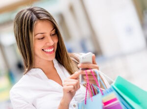 bigstock-Happy-woman-using-cell-phone-a-46756717-768x568